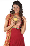 Indian Teenage girl showing credit card. Beautiful Teenage girl showing gold card Royalty Free Stock Images