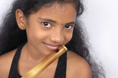Indian Teenage Girl With Flute Stock Images