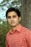 Indian Teenager. A portrait of a young Indian guy, in the outdoors Royalty Free Stock Photography