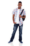 Indian teenager boy. Smiling indian teenager boy with schoolbag standing on white background stock photo