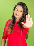 Indian teenager posse studio green background Stock Image