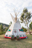 An indian teepee set up in a meadow among pine wood Royalty Free Stock Photography