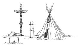 Indian teepee and totem Royalty Free Stock Photos