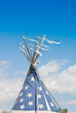 Indian Teepee in the Wind. Ribbons flutter from atop a Plains Indian teepee royalty free stock photography
