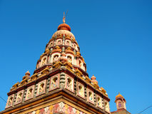 Indian temple. Top section of an old Indian temple against a clear blue sky Stock Photography