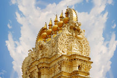 Indian temple. Gold roof top sculpture Royalty Free Stock Images