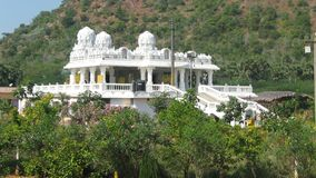 Indian temple complex admist hills and greenery. Indian Hindu temple of vaishno devi in visakhapatnam royalty free stock photo