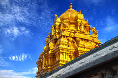 Indian Temple With Golden Roof. Decorated With Various Religious Statues Stock Photos