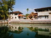 Indian temple near a pond. Outdoor scene of authentic Indian temple with reflections in a pond Stock Images