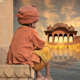 Indian temple. Old man near indian temple in the sunset Stock Photos