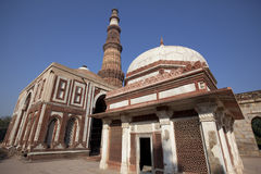 Indian temple with Qutub minar tower Royalty Free Stock Images