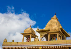 Indian temple's roof on blue sky background. Indian temple dome on blue sky background Royalty Free Stock Photo