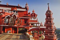Indian temples for prayers and forgiveness. South of the state is a small and very beautiful temple standing right on the road India, Goa, March 11, 2017 royalty free stock photography