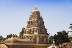 Indian temples for prayers and forgiveness. South of the state is a small and very beautiful temple standing right on the road India, Goa, March 11, 2017 royalty free stock images