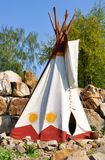 Indian tepee. On a rocky hill Royalty Free Stock Images