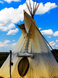 Indian Tepee Tent. And cloudy blue sky Royalty Free Stock Photos