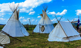 Indian Tepee Tent. And cloudy blue sky Royalty Free Stock Image