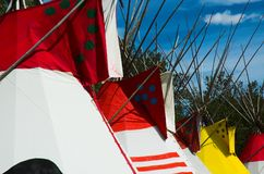 Indian Tepees. A row of colorful tepees at an Indian encampment on the north American plains royalty free stock images