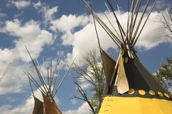 Indian Tepees. A row of colorful tepees at an Indian encampment on the north American plains royalty free stock image