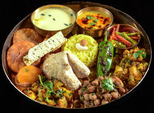 Indian Thali. Indian meal (Thali) consisting of different curry,flat bread,rice and papad Stock Photo