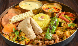 Indian Thali. Indian meal (Thali) consisting of different curry,flat bread,rice and papad Stock Image