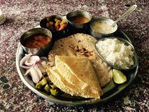 Indian Thali. Indian meal Thali consisting of different curry,flat bread,rice and papad Stock Photography