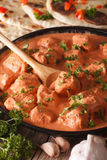 Indian tikka masala chicken close-up in a bowl. vertical Stock Photos