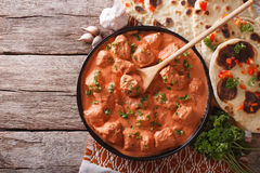 Indian tikka masala chicken on the table. Horizontal top view Stock Image