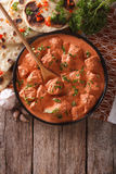 Indian tikka masala chicken on the table. vertical top view Stock Image