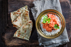 Indian tikka masala with rice and chicken in tomato sauce Stock Photos
