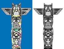 Indian totem carved owl and scary faces Stock Photography