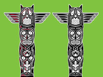 Indian totem carved owl and scary faces Stock Image
