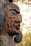 Indian totem pole face. A part of an Indian totem pole in Victoria's Inner Harbour, BC, Canada Stock Images