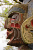 Indian totem pole face. A part of an old Indian totem pole in Victoria's Inner Harbour, BC, Canada Royalty Free Stock Images