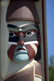 Indian Totem pole face. Native american art in Northwest USA Stock Photo