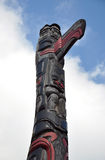 Indian totem. View of Indian totem pole with clouds in the background Royalty Free Stock Photo