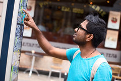 Indian tourist. Tourist looking at a map in the street Stock Photo
