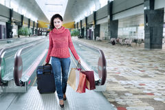 Indian tourist walking in the airport hall Stock Photography