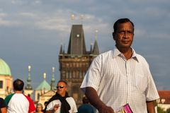 Indian tourist walks on Charles Bridge, Prague, Stock Photo