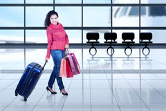 Indian tourist with winter clothes in airport Royalty Free Stock Images