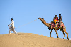 Indian tourists on the camel in Thar desert, Rajasthan, India Royalty Free Stock Photography