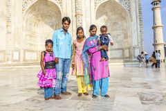 Indian tourists in front of the Taj Mahal in Agra, India. AGRA, INDIA - NOV 11: Unidentified people from rural villages visit the white marble mausoleum Taj Stock Photo