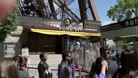 Indian tourists waiting in queue to visit Eiffel Tower stock footage
