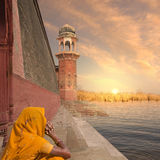 Indian tower. Woman near a traditional indian tower near Ganges Royalty Free Stock Image