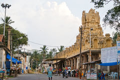 Indian town - main street scene. Main street in a small Indian town with a Hindu temple of God Narayana in a center, Melkote, Karnataka, India, 2010 Royalty Free Stock Image