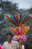Indian toys seller - Elephant festival, Chitwan 2013, Nepal Royalty Free Stock Photos