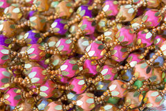 Indian traditional culture stuff from colourful beads. Pink violiet orange gold for holy religious ritual. Useful for background Stock Images