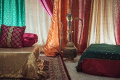 Indian traditional engagement interior traditional setup with colorful blankets and sofas. Stock Image