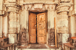 Indian traditional style design at entrance of historical Hindu temple with collumns and sculptures, India Royalty Free Stock Images