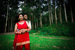 Indian Traditional Young Couple. A newly married Indian Couple in tradition dress Royalty Free Stock Image